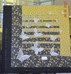Lace butterflies on quilt