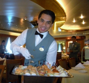 What's not to love about waiters in white gloves serving afternoon tea
